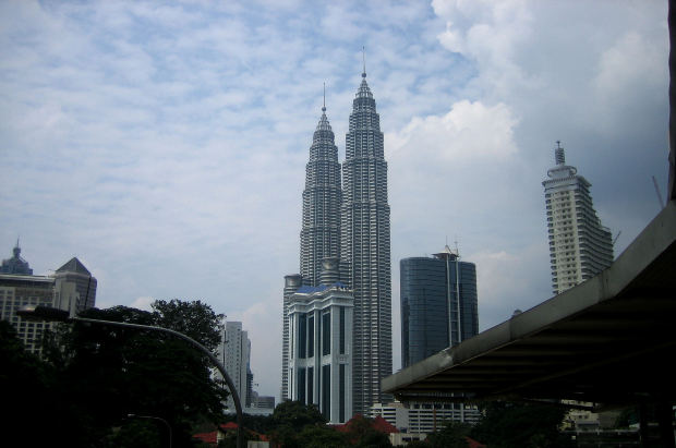 The Petronas Twin Towers stand firm in the center of Kuala Lumpur